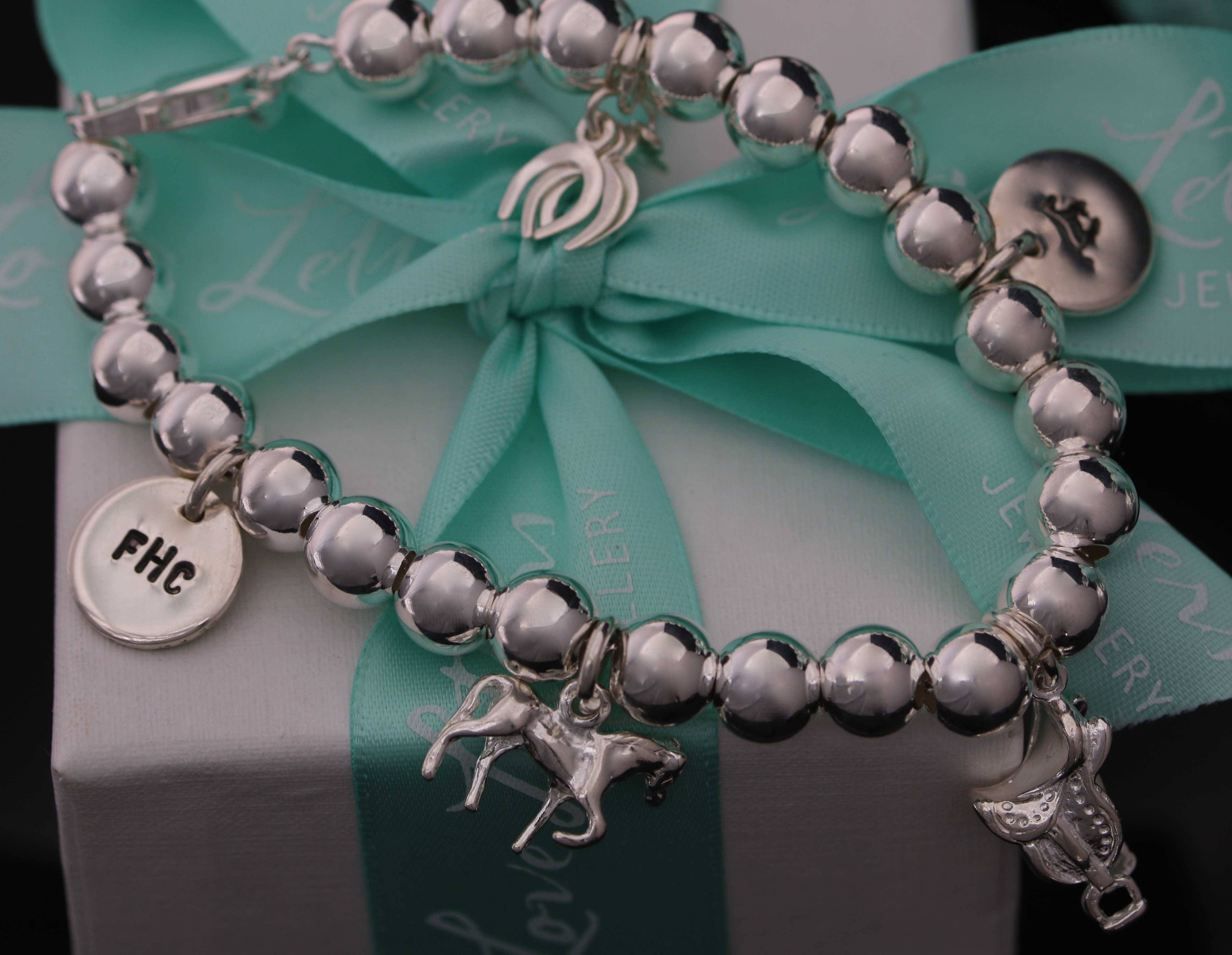 47231e38fd4dc Adore' Sterling Silver Ball Bracelet with an Equine Theme! - LoveLetters